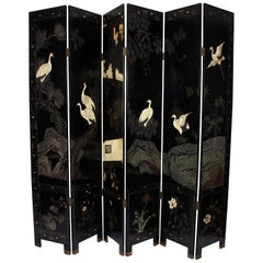 1920s Black Carved Japanese Screen with Architectural and Naturalistic Design