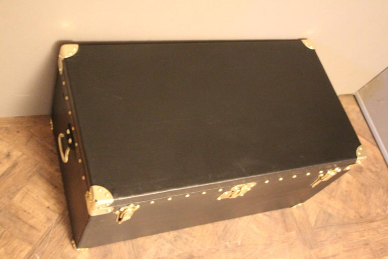 This very nice Louis Vuitton auto trunk in black canvas, features stamped LV solid brass locks and studs and leather side handles. Original interior. Perfect size to be used as a coffee table or side table.
