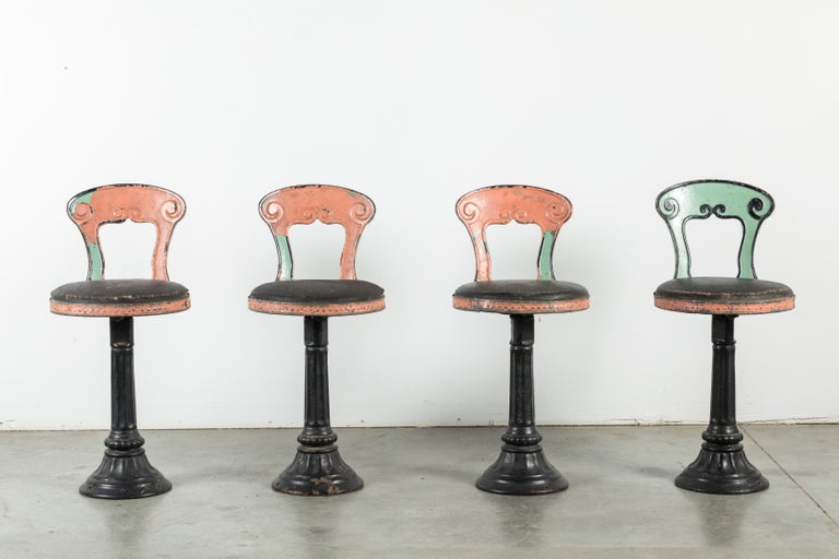 Great set of four cast iron soda fountain chairs. Found in the northeast. Original multi layer pink and green paint surface. Also original leather chair surface. Very nice cast iron bases.