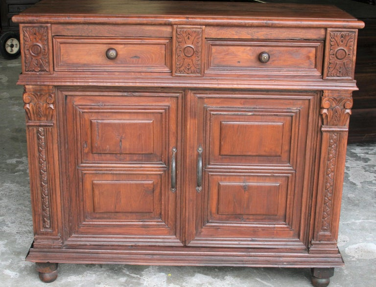 Superbly handcrafted this two doors and two drawers vanity once adorned the home of an European settler. The carvings on this piece is exceptional. The pictures show every aspect of the vanity. It is durable and will last several generations. The