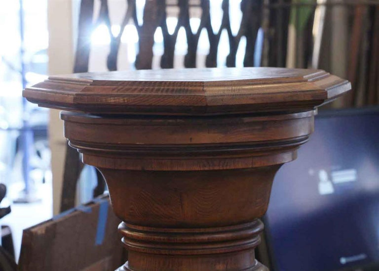 Dark wood tone oak pedestal with an octagonal pivoting and removable top from the 1920s. This can be seen at our 2420 Broadway location on the upper west side in Manhattan.