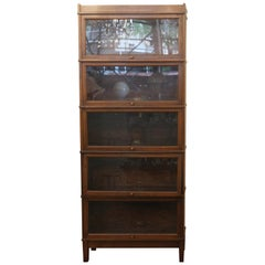 1920s Dark Wood Tone Five-Section Barrister Bookcase with Pull Out Glass Doors