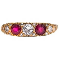 1920s Diamond and Ruby Band Ring, 18 Karat Gold