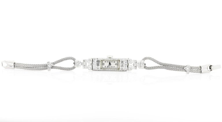 A refined Swiss made Diamond lady's watch.  Created in platinum and set with a medley of old Single and Baguette cut Diamonds, all weighing an approx.  1.40 carat of G/I color - VS clarity.   A mesh rope like band completes this 6 inches long circa