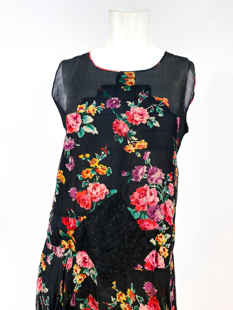 1920s custom-made Floral printed chiffon evening dress with applied drop waist, black lace and chiffon overskirt, Art Deco bodice with shear panels, and hand rolled edges. The dress if fully lined.