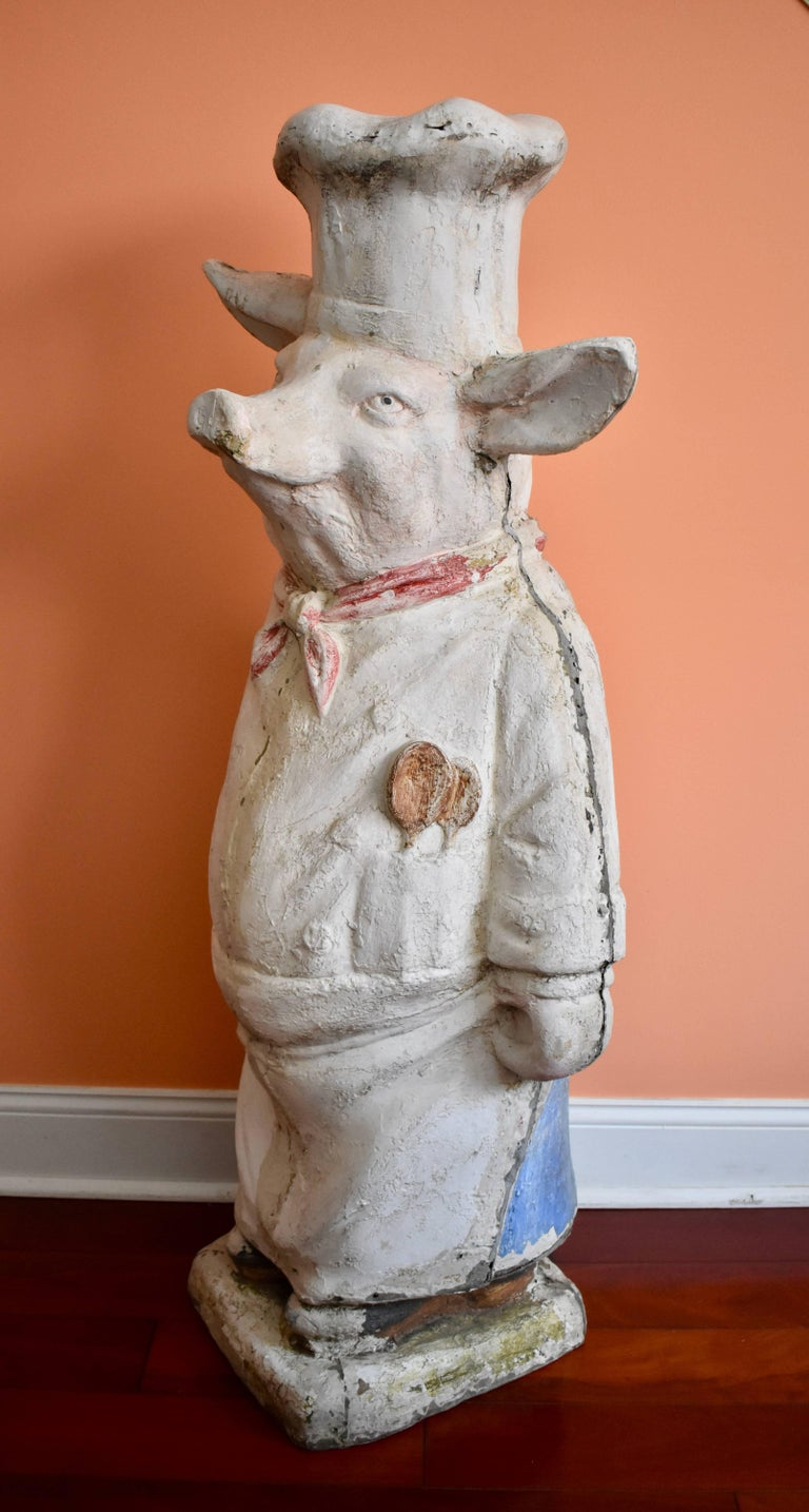 Fabulous for a restaurant, bar, gourmet food shop, or a home kitchen, an authentic French butcher shop pig, circa 1920s, made of plaster covered composite. Standing over four feet high and displaying a marvelous personality, he would have been