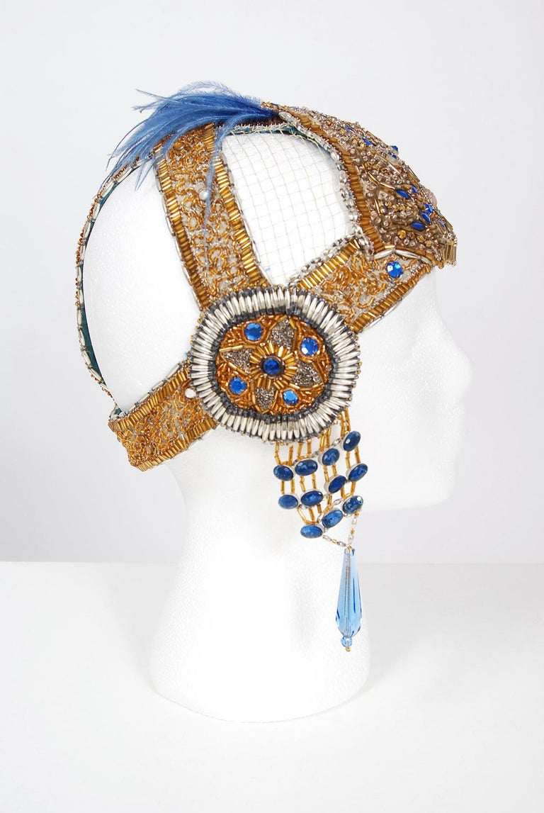 Breathtaking 1920's French metallic gold beaded and sapphire-blue jeweled flapper headdress. This is, without a doubt, one of the most extraordinary antique flapper period pieces I have ever laid eyes on. Large scale jewels, gold sequins and