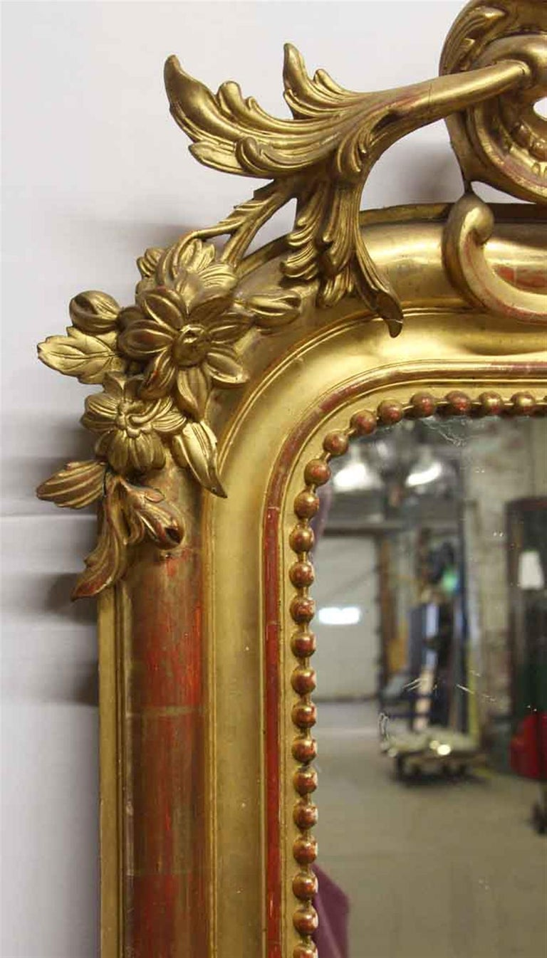 Early 20th Century 1920s French Hand Carved and Gesso Gilded Over Mantel Mirror with Floral Details For Sale