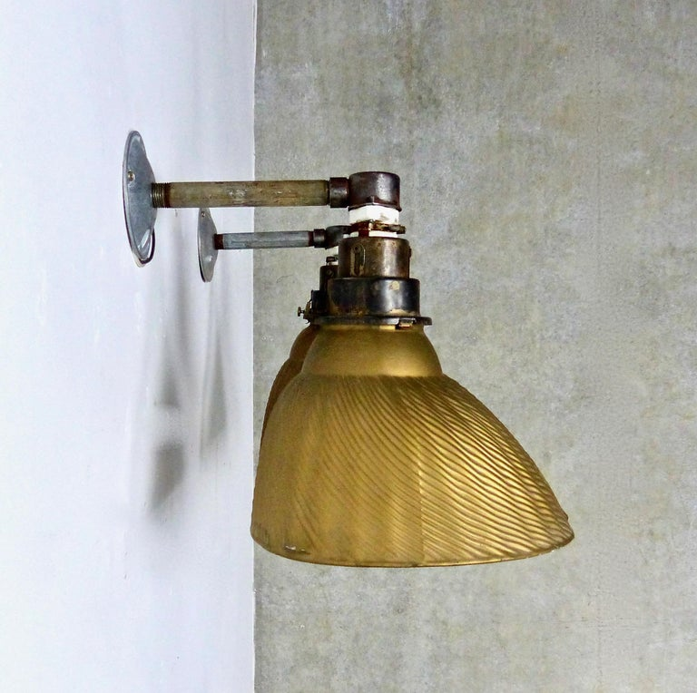 Matched pair of authentic mercury X-ray wall sconces with 'Golden Armor' fluted shades (510 Queen). Produced by Curtis Lighting of Chicago, IL, a pioneer of indirect lighting, X-ray shades feature metal shades lined with mercury glass, which creates