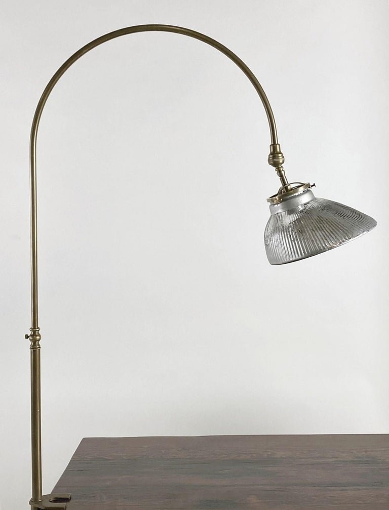 1920s brass gooseneck desk lamp made with a mercury glass shade. Features a 10 foot cord with a thumb on/off switch. Uses a normal household light bulb. Small quantity available at time of posting. Priced each. This can be seen at our 400 Gilligan