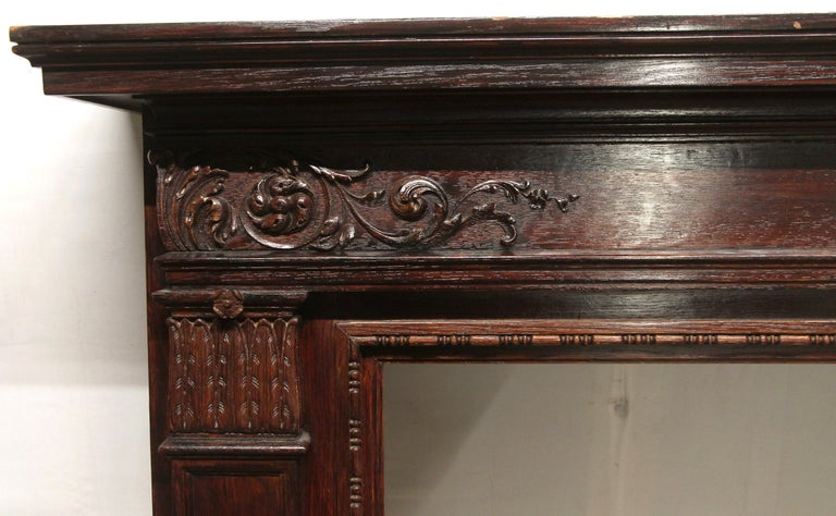 American 1920s Hand Carved Wood Federal Style Mantel with a Dark Mahogany Finish For Sale
