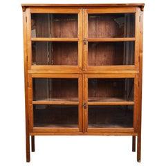 1920s Indonesian Teak 4-Door Glass Panel Cabinet