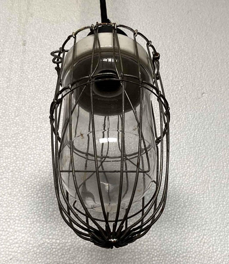 American 1920s Industrial Cage Pendant Light with Porcelain Fixture and Steel Cage For Sale