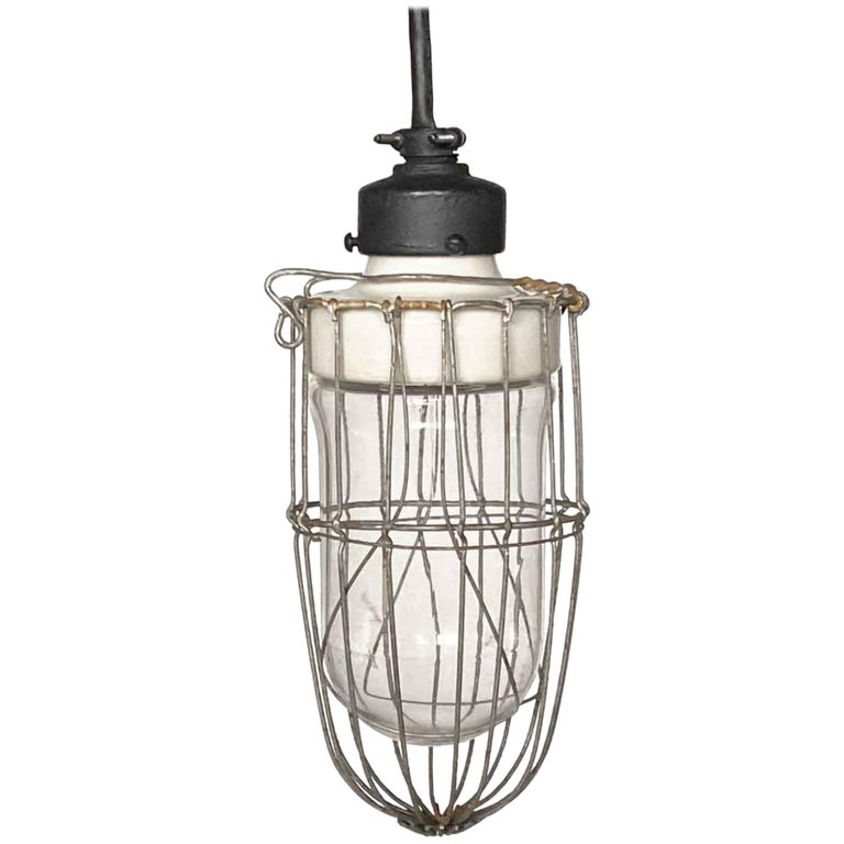 1920s Industrial Cage Pendant Light with Porcelain Fixture and Steel Cage For Sale