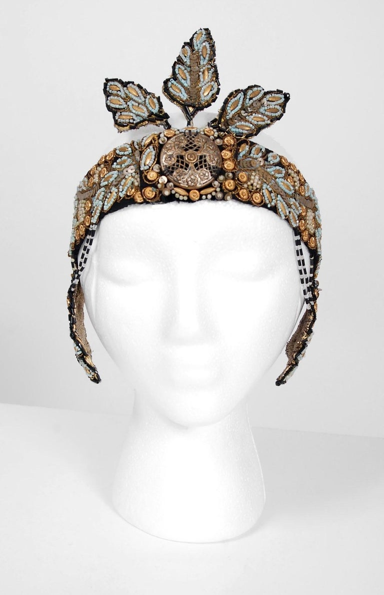 Breathtaking French Couture metallic-gold and turquoise flapper formal headpiece dating back to the mid 1920's. This is, without a doubt, one of the most extraordinary antique crowns I have ever laid eyes on. Gorgeous tube glass-beads and