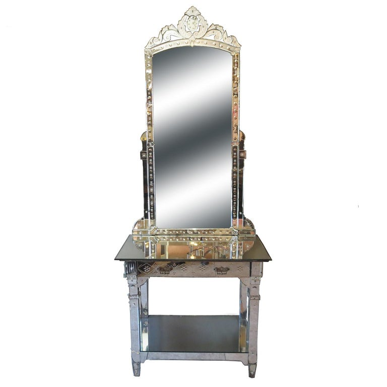 This glamorous mirrored vanity came from the Hollywood apartment of Bette Davis near Sunset Boulevard. It features multiple panels of beveled mirror, decorated with floral etched designs. There is overall wear and some chipped panels. A few of the