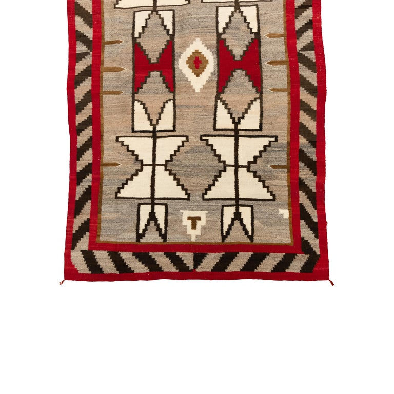 Navajo Crystal area weaving with stylized feathers on sides,