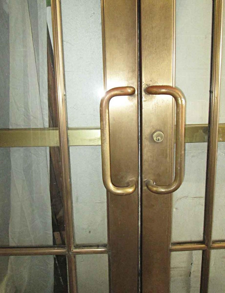American 1920s Pair of Antique Brass Entryway French Doors with 9 Lites Each For Sale