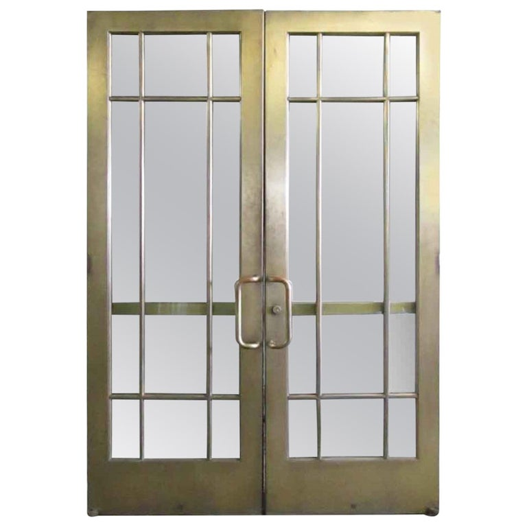1920s Pair of Antique Brass Entryway French Doors with 9 Lites Each For Sale
