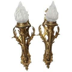 1920s Pair of Bronze Ornate Sconces with Glass Torch Shades