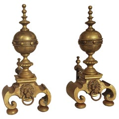 1920s Pair of Lion Brass Andirons with Large Decorated Ball Finials