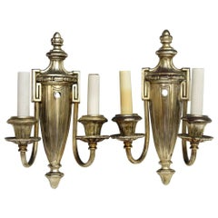 1920s Pair of Neoclassical Silvered Brass Sconces with Greek Urn and Key Detail