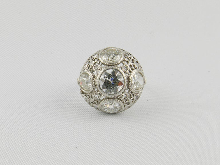 This amazing 1920s Platinum engagement Ring , centers a sparkling old mine cut Diamond that weighs 0.90 cts. Accentuating the center stone are 4 dazzling old mine cut Diamonds, 2 weighing 0.70 cts and 2 weighing 0.60 cts. A further 12 small old mine