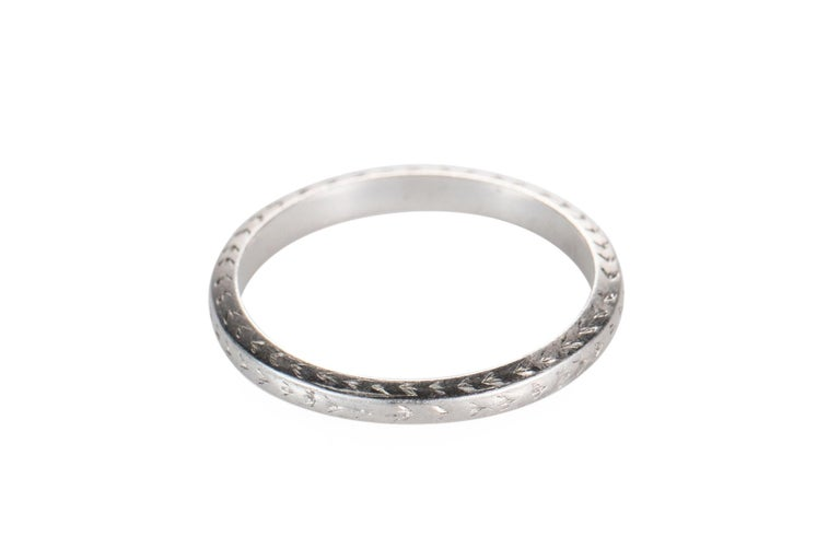 Item Details: Metal Type: Platinum Weight: 3 grams Size: 7 (non resizable)  Absolutely stunning wedding band from the 1920s, art deco era. This ring is crafted entirely in platinum and features etching design work on the side profile and top. The