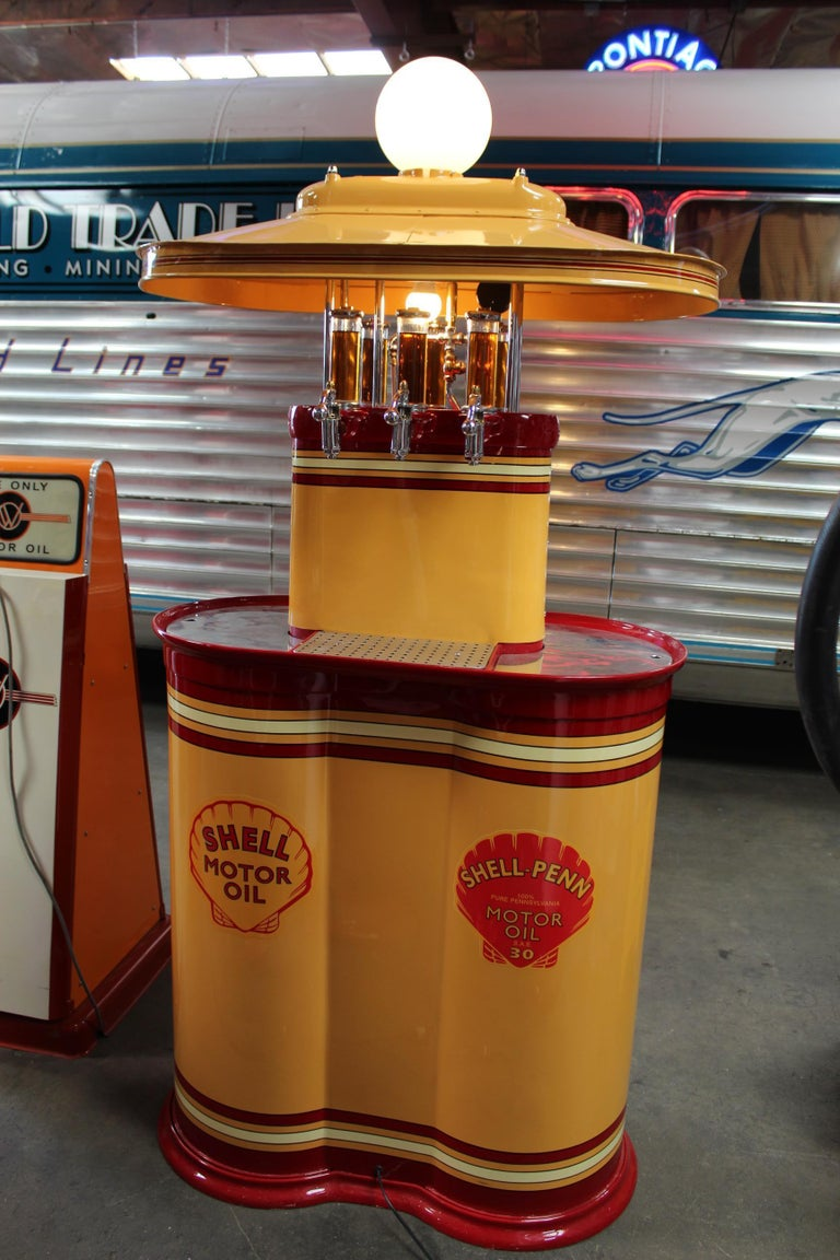 1920sPremier oil fountain model 62 island oil dispenser. Very rare and hard to find piece. This was originally located in Nevada in an old abandoned building. The gentleman who found it went to the local post office to find the owner of the