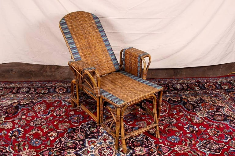 Rattan frames with tan and blue striped wicker. The lounge with adjustable back and angular and curved stretchers. With a slide out ottoman below.