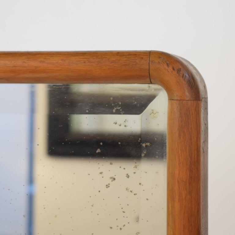 This beautiful 1920s rotatable German Art Deco Cheval Dressing Mirror has still its original mirror glass. It is light brown birch veneer on pine. The mirror without base is 150cm in height, 53cm wide and 7cm deep. It is connected with a metal pin