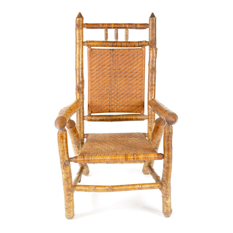 An uncommon, substantial rustic armchair built of Silver Birch with a double-caned seat and back.