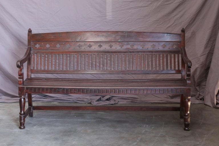 The seat and the back of this bench is shaped for comfort. It is superbly crafted in old world style with religious symbols. It comes from a bishop's abode and is in excellent condition. It is priced low. Will make a great addition to a family room.