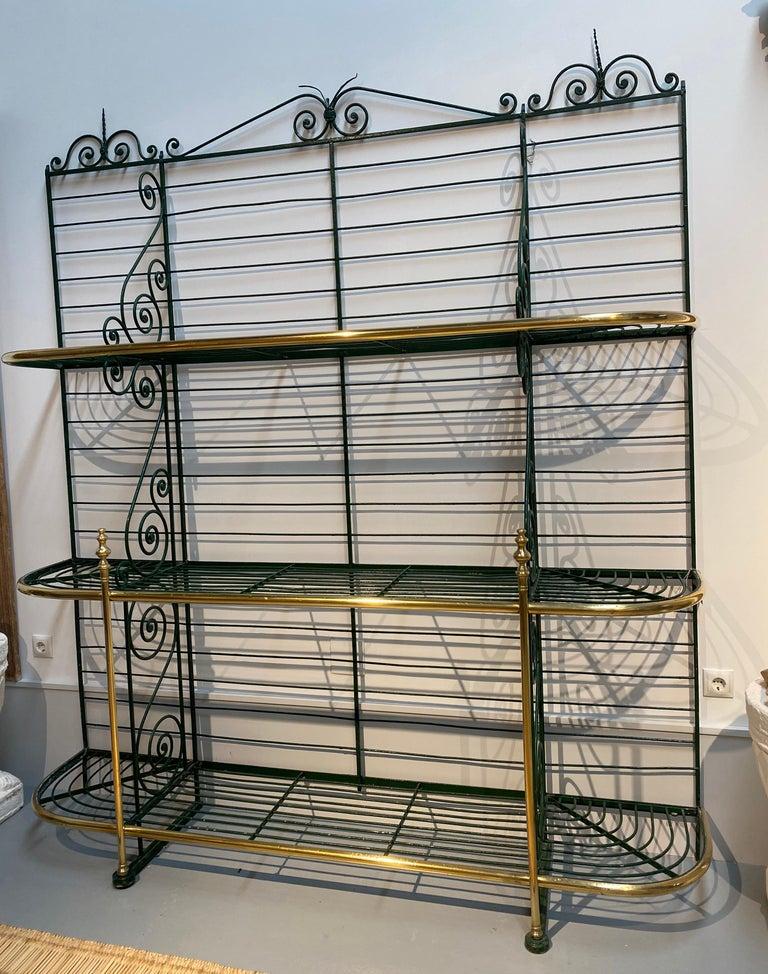 1920s Spanish bronze and iron three shelf bakers rack.