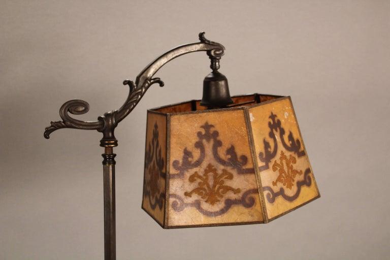 Spanish Revival bridge lamp with original mica shade, circa 1920s. Light flaking on shade.