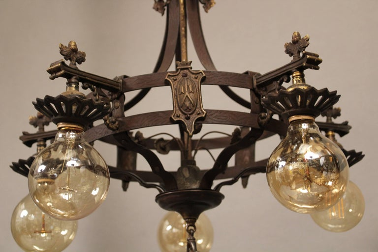1920s spanish revival downlight chandelier with shields at 1stdibs