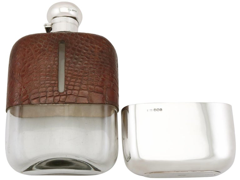 A magnificent, fine and impressive, large antique George V glass, English sterling silver and crocodile skin mounted hip flask; an addition to our silver mounted glass collection.