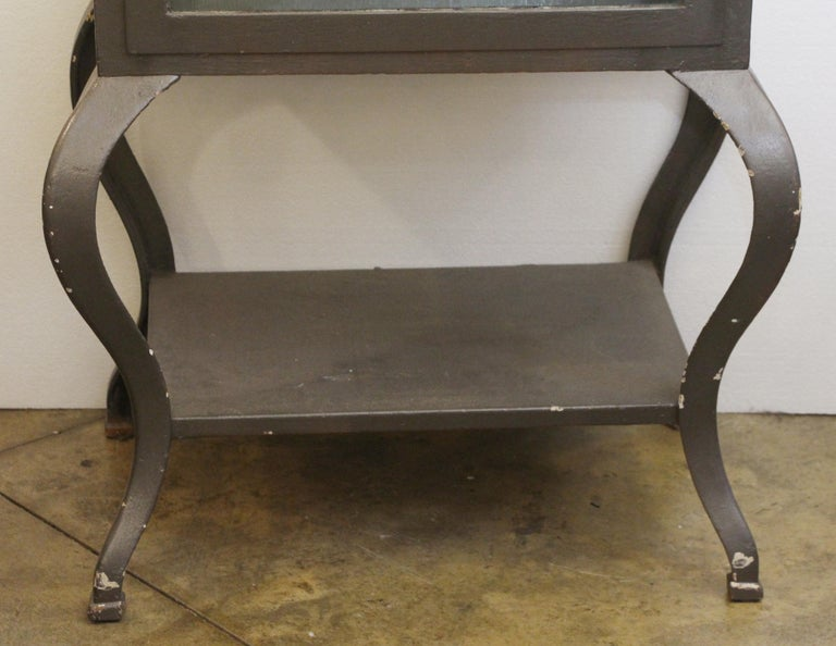 Industrial 1920s Stripped and Lacquered Steel Dental Cabinet with Cabriole Legs and Shelves For Sale