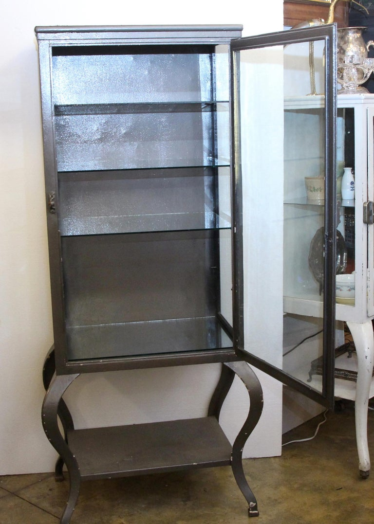 American 1920s Stripped and Lacquered Steel Dental Cabinet with Cabriole Legs and Shelves For Sale