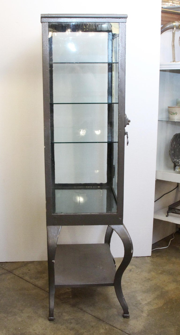 1920s Stripped and Lacquered Steel Dental Cabinet with Cabriole Legs and Shelves In Good Condition For Sale In New York, NY