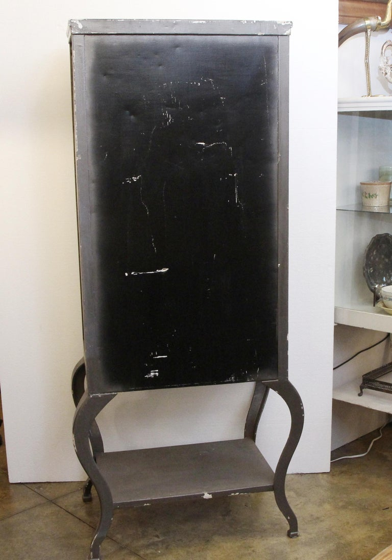 Early 20th Century 1920s Stripped and Lacquered Steel Dental Cabinet with Cabriole Legs and Shelves For Sale