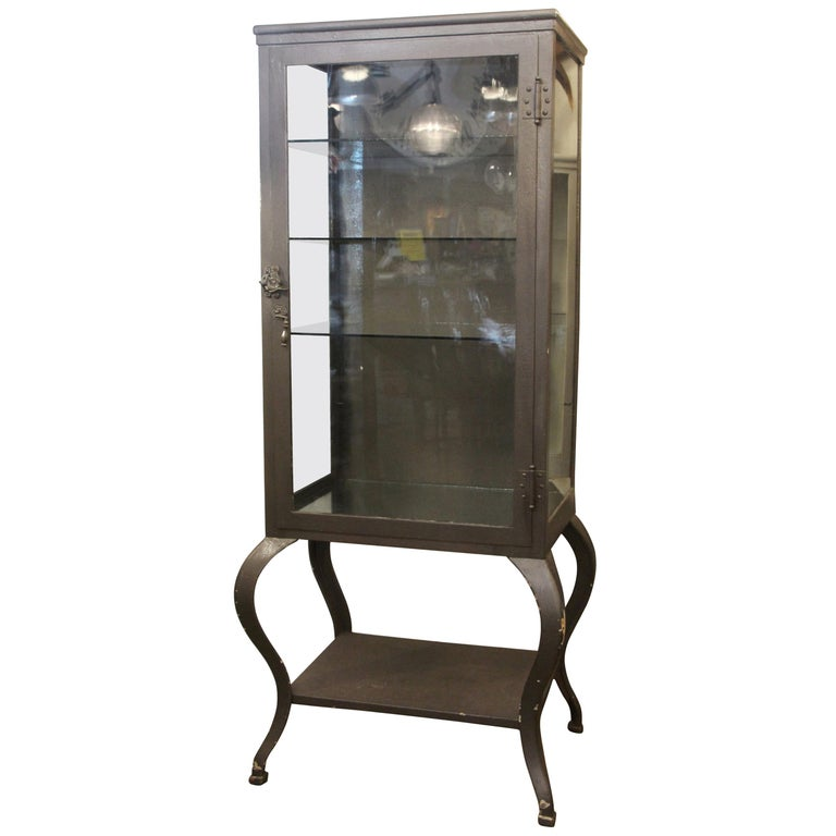 1920s Stripped and Lacquered Steel Dental Cabinet with Cabriole Legs and Shelves For Sale
