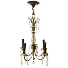 1920s Victorian Four Arm Bronze Chandelier Featuring Glass and Hanging Crystals