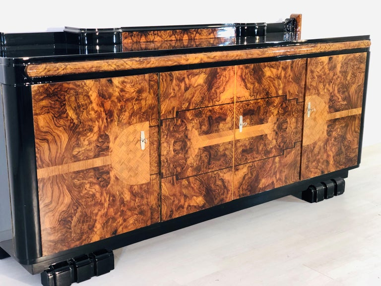 On sale until February 10th, will be taken offline and auctioned in February. Therefore it is available for a limited sale price for a very limited time. Reach out with any questions.   Stunning original Art Deco sideboard made of walnut and walnut