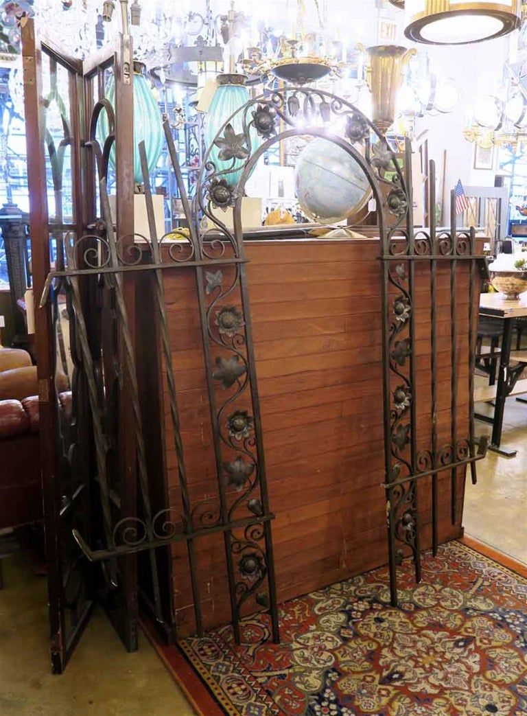 1920s cast and wrought iron gateway arch with Art Nouveau details and a black finish. This can be seen at our 2420 Broadway location on the upper west side in Manhattan.