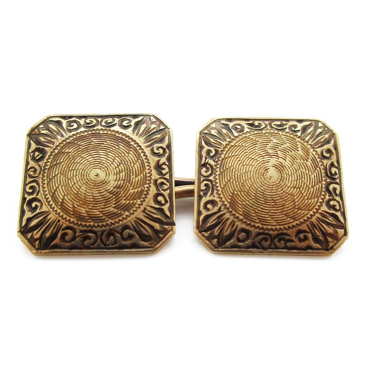 An excellent Hayden and Wheeler design in 14k yellow gold, these Art Deco cufflinks are the perfect gentleman's accessory! The panels are square-shaped with clipped corners that make them unique. The panels are decorated with an arching, scroll