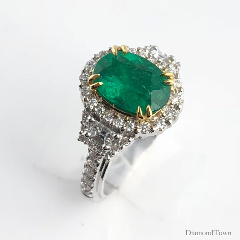 Contemporary 1.93 Carat Oval Cut Emerald and Diamond Ring For Sale