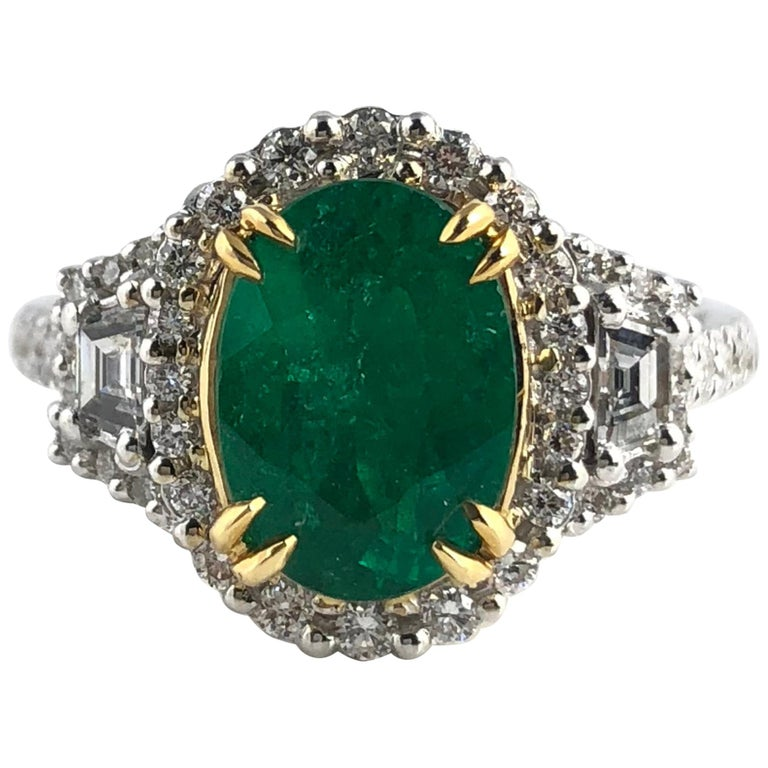 1.93 Carat Oval Cut Emerald and Diamond Ring For Sale