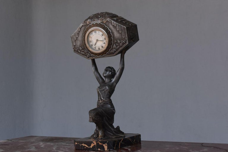 Art Deco 1930 pendulum dancer in regulates on marble base portor movement of the pendulum to be revised or repaired.