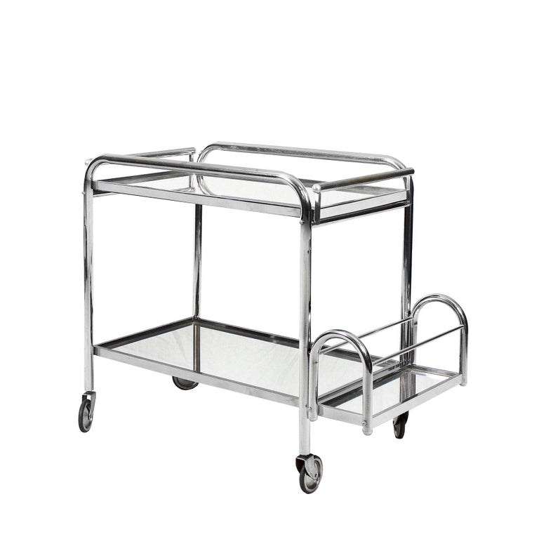 Art Deco bar cart, nickel-plated metal and mirror. Removable tray and bottles holder.  Design: Jacques Adnet  France circa 1930.